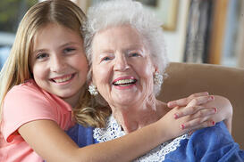 Grand daughter shares a hug in Grandma's assisted living facility