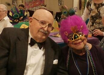 assisted_living_houston_tx_couple_celebrate_Mardi_Gras