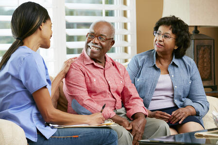 senior_couple_discussing_senior_living_houston_options_with_care_provider