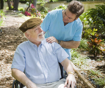 assisted_living_houston_resident_treemont_with_caregiver